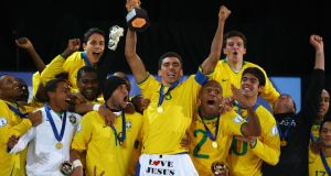 Lucio of Brazil lifts the trophy as his team-mates celebrate following their victory at the end of the Fifa Confederations Cup Final between USA and Brazil at the Ellis Park Stadium on June 28, 2009 in Johannesburg, South Africa. Photograph: Alex Livesey/Getty Images