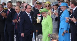 French president François Hollande and Queen Elizabeth at the international ceremony at Sword Beach to commemorate the 70th anniversary of the D-Day invasion, in Ouistreham, France, yesterday. Photograph: Peter Macdiarmid/Getty Images