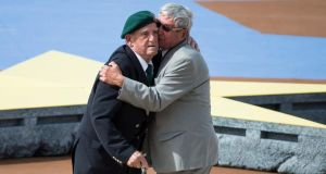 French World War two veteran Leon Gautier of the Kiieffer commando (left) and German veteran paratrooper Johannes Borner embrace as a sign of reconciliation during an international ceremony marking the 70th anniversary of the Allied landings on D-Day on Sword Beach in Ouistreham, in Normandy, France, yesterday. Photograph: EPA/Ian Langsdon