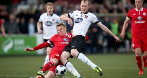 Dundalk's Chris Shields is tackled by Danny North of Sligo at Oriel Park. Photo: Ryan Byrne/Inpho