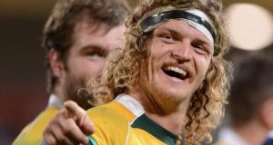 Australia's   Nick Cummins celebrates after the final whistle at Suncorp Stadium in Brisbane. Photograph: Dave Hunt / EPA