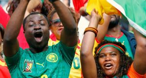 Cameroon supporters cher on their team ahead of their departure for the World Cup.  Photograph: Ralph Orlowski / Reuters