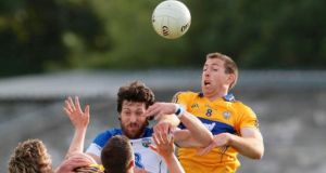 Tommy Prendergast of Waterford with Gary Brennan of Clare at Cusack Park. Photograph: Mike Shaughnessy / Inpho