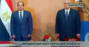 Former army chief Abdel Fattah al-Sisi (l) stands prior to his swearing-in ceremony as Egypt's new president in Cairo. Photograph: Egyptian State Television