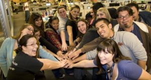 "Zappos staff: ""Like American high school kids celebrating the end of term."" Photograph: Zappos"