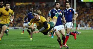 Australia's Nick Cummins scores a try against France during their international rugby union match at  in Brisbane on Saturday. Photograph: Jason O'Brien/Reuters