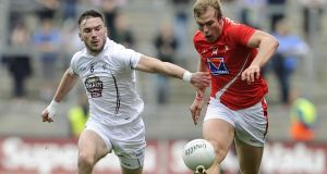 Louth's Conor Grimes and Fergal Conway of Kildare. Photograph: Inpho