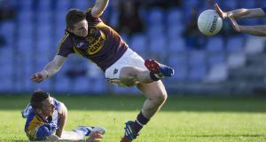 Wexford's John Tubritt attempts a shot which is blocked at Pearse Park. Photograph: Inpho