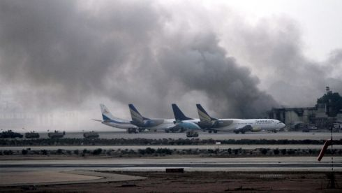 Smoke billows from inside Jinnah International Airport, Karachi, Pakistan, after 27 people were reported killed in a night-long battle. The Pakistani Taliban, an alliance of insurgent groups fighting to topple the government and set up a Sharia state, claimed responsibility, saying it was in response to army attacks on their strongholds along the Afghan border.  Photograph: Rehan Khan/EPA