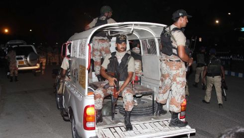 Pakistani Rangers secure the Jinnah International Airport in Karachi, Pakistan's largest city, late on Sunday night. Photograph: Rehan Khan/EPA