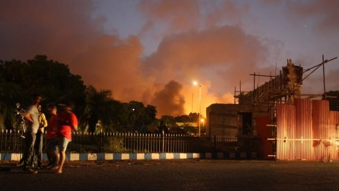 Smoke billows from inside the Jinnah International Airport in Karachi, Pakistan. The Pakistani Taliban have claimed responsibility, saying it was in response to army attacks on their strongholds along the Afghan border. Photograph: Rehan Khan/EPA