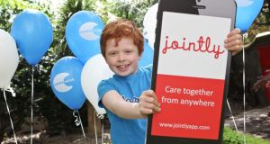Finian Duff Lennon (9) from Dublin helps promote the Jointly app.