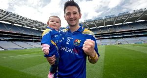 Longford's Conor Egan celebrates with his daughter Elaine in Croke Park after victory in the Lory Meagher Cup final at the weekend. Photograph: Ryan Byrne/Inpho