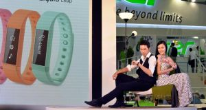 Models with the Acer Liquid Leap smartwatch at the Taipei Computex Taipei 2014 expo: Taiwan is looking to China for growth and its larger neighbour accounts for one-third of all smartphones sold worldwide this year. photograph: chris stowers/bloomberg