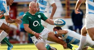 Ireland's Luke Marshall is tackled during the win over Argentina last Saturday. Photograph: Billy Stickland/Inpho