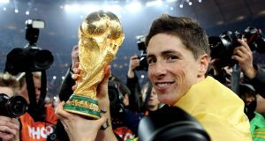 Spain's Fernando Torres celebrates with the trophy after winning the 2010 World Cup final. The tournament was one topic students were able to work with.  Photograph: Inpho