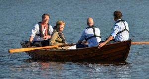 From left: British Prime Minister David Cameron, German Chancellor Angela Merkel, Swedish Prime Minister Fredrik Reinfeldt and Dutch Prime Minister Mark Rutte take a boat ride with Reinfeldt handling the oars in a lake at Reinfeldt's summer residence Harpsund, south-west of Stockholm, Sweden. during an evening break in their talks on EU and the the new European Parliament.