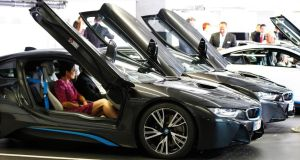 The buyers of the new BMW i8 receive delivery of their cars in Munich. Photograph:  Michaela Rehle/Reuters