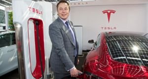 "Tesla CEO Elon Musk with the new right-hand-drive Model S. ""We want to accelerate the advent of electric cars,"" he said. Photograph: David Rawcliffe/Propaganda"