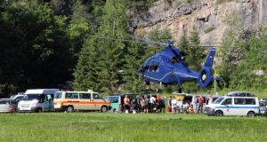 A helicopter lands at the foot of Hochthron mountain in the Alps near Berchtesgarden, Germany, amid the rescue effort at Riesending cave. Photograph: Aktivnews/EPA