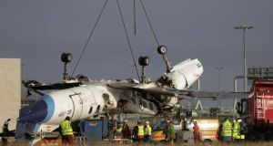 The destroyed plane is removed from Cork Airport. Photograph: Niall Carson/PA Wire