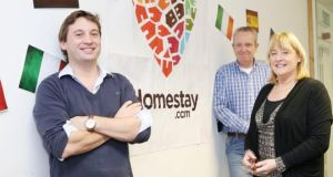 Homestay.com CEO Alan Clarke with co-founders Tom Kennedy and Debbie Flynn.