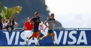 Steven Gerrard trains with a member of the England coaching staff  in Rio de Janeiro. Photograph: Eddie Keogh/Reuters