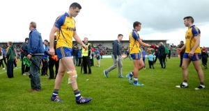 Roscommon's Donie Shine leaves the field injured after the Connacht SFC semi-final defeat to Mayo at Dr Hyde Park. The forward suffered a ruptured posterior cruciate ligament in the game.   Photograph: James Crombie/Inpho