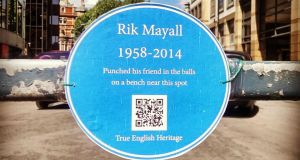 A temporary English Heritage style blue plaque in Hammersmith, west London, dedicated to the comic actor Rik Mayall who died yesterday. Photograph: Rupert Basham/PA