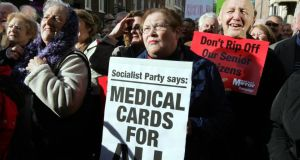 'We've been down this dubious road of universal entitlement before. Free university fees were sold as the way to get working class kids into college but ended up overwhelmingly subsidising the education costs of the middle classes. The distribution of free medical cards for all over-70s had to be reversed within a decade.' Above, people taking part in a protest about  medical cards for those aged 70 and over, in 2008. Photograph: Eric Luke