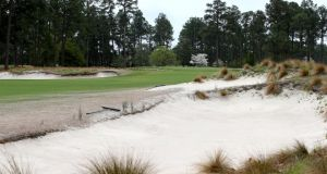 "The par-five 10th at Pinehurst. The renovation of the course, described as ""funky"" by coach Pete Cowen, meant the removal of more than 40 acres of rough, which was replaced by native vegetation that includes clumps of wiregrass on sandy areas adjoining the fairways. Photograph: Streeter Lecka/Getty Images"
