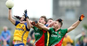 Mayo's Aidan O'Shea and Seamus O'Shea lose out to Roscommon's Cathal Shine in Sunday's Connacht football championship semi-final at Dr Hyde Park.