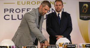 Simon Shaw and  Scott Quinnell conduct the draw for the European Rugby Champions Cup in Neuchatel, Switzerland yesterday. Photograph:  Philipp Schmidli/Getty Images.
