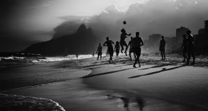 Locals while away the hours on Rio's Ipanema Beach before the start of the greatest sports show on earth tomorrow. Photograph: Getty Images