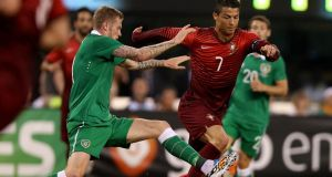 James McClean of the Republic of Ireland challenges Cristiano Ronaldo of Portugal during the friendly international at MetLife Stadium in New Jersey. Photograph:  Donall Farmer/Inpho