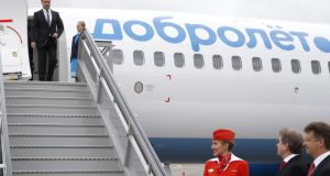 Russian prime minister Dmitry Medvedev inspects a Boeing 737-800  aircraft operated by the Dobrolet airline as Aeroflot general director Vitaly Savelyev  and Russian transport minister Maxim Sokolov (right) look on. Photo: EPA/Dmitry Astakhov