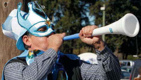 An Argentine soccer fan plays a vuvuzela as he waits to see the bus carrying the squad to board a plane for Belo Horizonte to participate in the 2014 Brazil World Cup, in Buenos Aires. Picture: Reuters