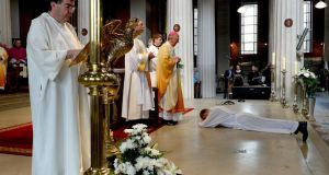 Seamus McEntee lies prostrate before  Archbishop of Dublin Diarmuid Martin during his ordination at St Mary's Pro Cathedral in Dublin  last week. Photograph: David Sleator/The Irish Times