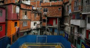 You don't have to go very far to find a five-a-side pitch among the many favelas in Rio de Janeiro, like this one at the Tavares Bastos slums. Photograph: Pilar Olivares/Reuters