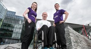 Mark Rohan (centre) in Dublin yesterday with paralympic swimmer Ellen Keane and CP footballer Gary Messett. Photograph: Cathal Noonan/Inpho.