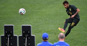 Brazil's Neymar practising his free-kick technique at the Arena de Sao Paulo ahead of the hosts' World Cup opener against Croatia. Photo: Christopher Lee/Getty Images
