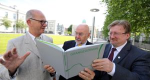Minister Ruairí Quinn is  presented with a copy of a new book telling the story of the Grangegorman development. Also pictured are James Mary O'Connor, lead designer of the Grangegorman Campus and DIT president Prof Brian Norton.