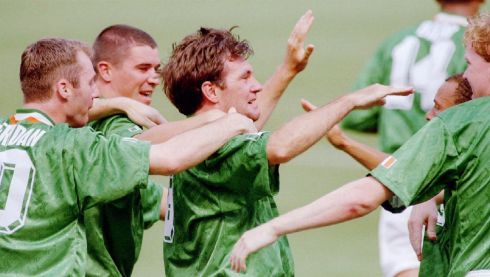 Ireland's Ray Houghton (C) is mobbed by his teammates after he scored the first goal during first half action at the World Cup match between Italy and Ireland in East Rutherford New Jersey June 19. Ireland upset Italy 1-0. ms/str-Ray Stubblebine REUTER