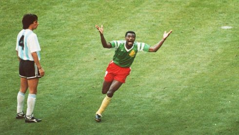 F. BIYIK OF CAMEROON CELEBRATES AFTER SCORING AGAINST ARGENTINA DURING THE 1990 WORLD CUP IN ITALY. Mandatory Credit: David Cannon/ALLSPORT