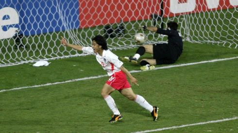 Jung Hwan Ahn of South Korea heads the winning goal passed goalkeeper Gianluigi Buffon of Italy as South Korea knock Italy out of the World Cup by winning 2-1 in the golden goal period during the second half