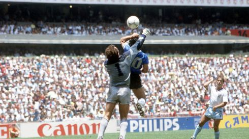 "Argentina's Diego Maradona scores his side's first goal past English goalkeeper Peter Shilton by use of his hand, Maradona later claimed that the goal was scored by ""The Hand Of God,"" (Photo by Bob Thomas/Getty Images)"