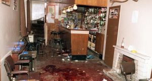 Havoc: the interior of O'Toole's bar in Loughinisland the morning after   Rogan and fiver other men were gunned down. Photograph: Pacemaker