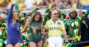 Brazilian singer Claudia Leitte, US singer Jennifer Lopez, and US rapper Pitbull perform during the opening ceremony prior to the FIFA World Cup 2014 group A preliminary round match between Brazil and Croatia at the Arena Corinthians in Sao Paulo this evening. Photograph: Tolga Bosoglu/EPA
