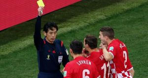 Yuichi Nishimura shows Dejan Lovren of Croatia  a yellow card after awarding the penalty kick to Brazil. Photograph: Elsa/Getty Images