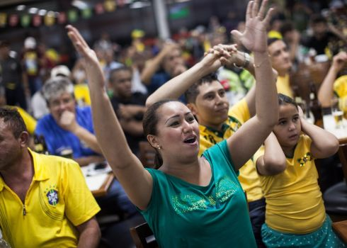 Fans pictured during the opening match of 2014 World Cup at the FIFA Fan Fest at Anhangabau Valley in Sao Paulo. Photograph: Victor Moriyama/Getty Images